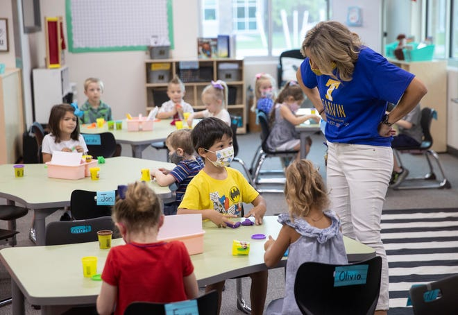 Kindergarten teacher Rosalyn Haug leads her class on the first day of school at Tarvin Elementary School in Leander on Aug. 12. The district has reported more than 400coronavirus cases since school began.