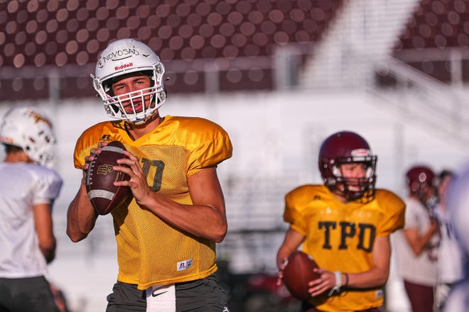 """Dripping Springs quarterback Austin Novosad returns to lead the Tigers, who have steadily improved under head coach Galen Zimmerman over the past five years. """"We want to set the standard to be a district champion every year,"""" Novosad said."""