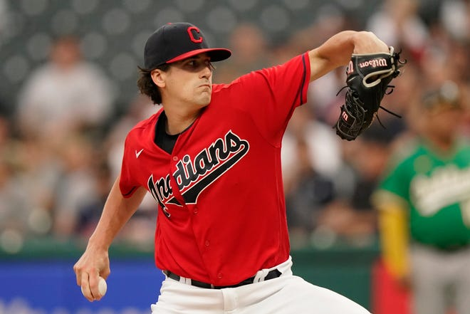 Cleveland starting pitcher Cal Quantrill delivers during the first inning of the team's baseball game against the Oakland Athletics, Wednesday, Aug. 11, 2021, in Cleveland. (AP Photo/Tony Dejak)