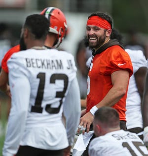 """Browns quarterback Baker Mayfield (6) shares a laugh with wide receiver Odell Beckham Jr. (13) during a training camp practice. NBC analyst Cris Collinsworth called the perception of a disconnect between Mayfield and Beckham a """"crock."""" [Jeff Lange/Beacon Journal]"""