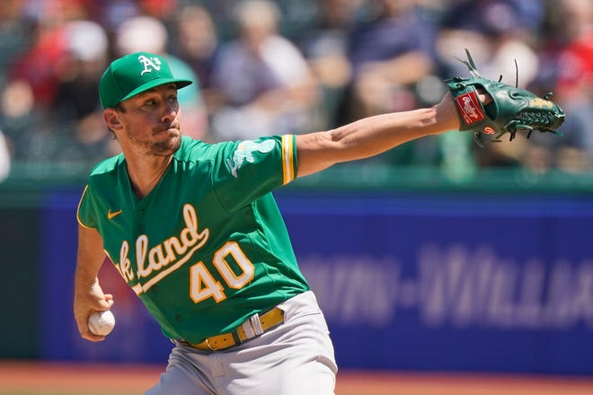 Oakland Athletics starting pitcher Chris Bassitt pitched six shutout innings against Cleveland on Thursday afternoon at Progressive Field. Bassitt, a product of the University of Akron, grew up rooting for all of Cleveland's pro teams [Tony Dejak/Associated Press]