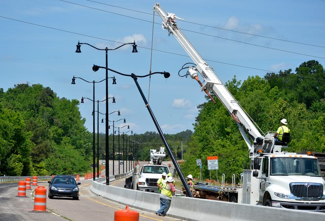 Workers install new street lights along Riverwatch Parkway in Augusta in 2016.
