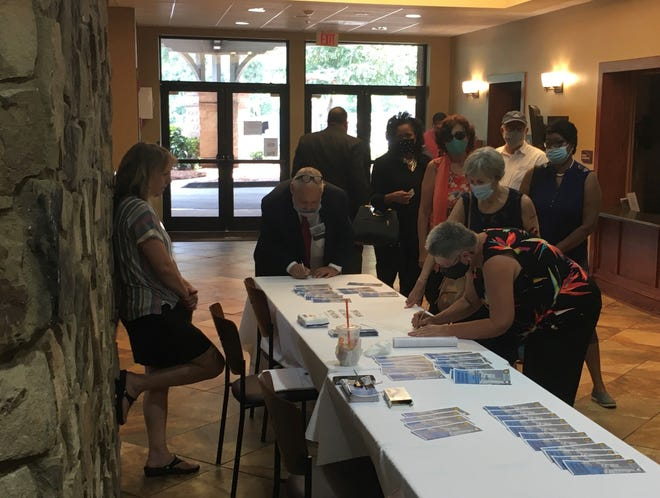 Residents sign up to speak at the final public redistricting hearing at the Savannah Rapids Pavilion in Martinez on Wednesday, Aug. 11.