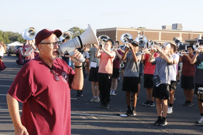 David Lambert, director of bands for the Brownwood school district, addresses the high school marching band during a practice Thursday morning. The band will be playing at the Meet the Lions event, which begins at 7 p.m. Friday at Gordon Wood Stadium.