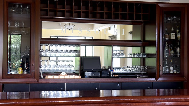 The bar at the University Club in the Reynolds Alumni Center held club members' personal wine, which was available to members when they stopped in to dine.