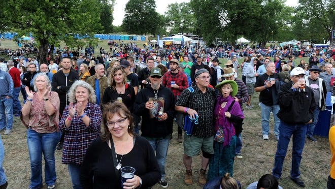 Concertgoers listen to Davy Knowles Band during the 2018 Roots N Blues festival.