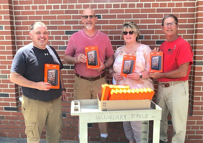 The Penn Yan Elks lodge donated 22 Kindle Fire HD computer tablets to the Psychosocial Rehabilitation and Recovery Center (PRRC) at the Canandaigua VA Medical Center. Ron Dailey, Exalted Ruler of Penn Yan Elks Lodge 1722; Jamie Sisson, N.Y.S. Elks Community Activities Chair; Tina Notabaert of the PRRC; Paul Enos, Penn Yan Elks Lodge Veterans Chairman.