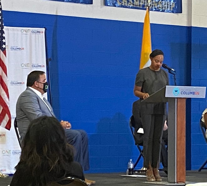 Columbus Mayor Andrew Ginther looks on as Columbus Health Commissioner Dr. Mysheika Roberts speaks Thursday during a news conference at the Far East Recreation Center about the nonprofit CelebrateOne and its efforts to reduce the infant mortality rate in Franklin County.