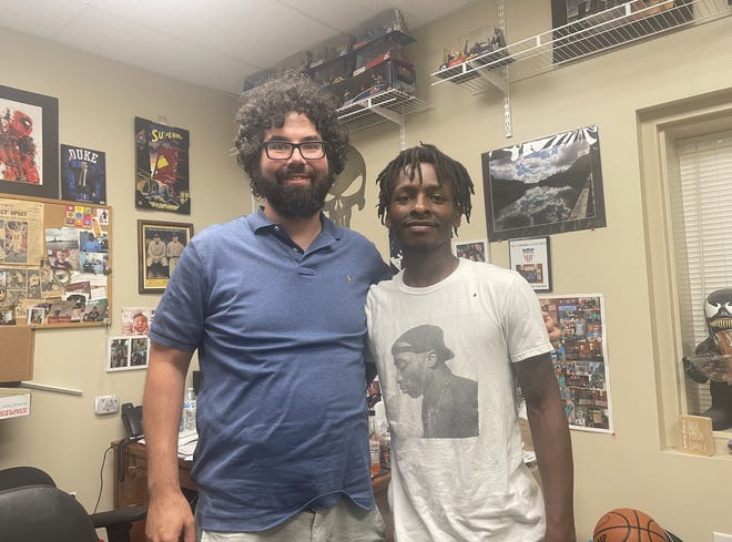 Joe Taureck (left), the organizer of the YMCA basketball program, and Briant Person (right), one of the kids who graduated from the midnight basketball program