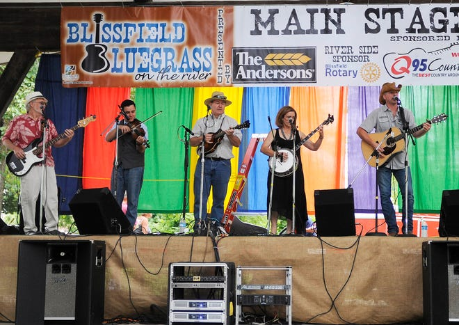 The Fossil Creek Band, from Lambertville, Ohio, perform during the 2015 Blissfield Bluegrass on the River music festival. The outdoor music festival, hosted in Blissfield's Bachmayer Park, returns Saturday, Aug. 14, for its 10th anniversary.