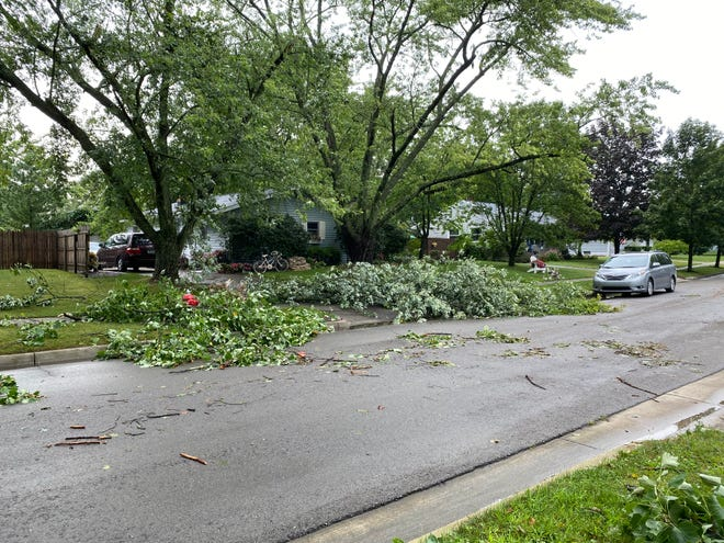 Several fallen branches are seen Wednesday afternoon at a house on Wenonah Street in Tecumseh after a severe thunderstorm passed through.