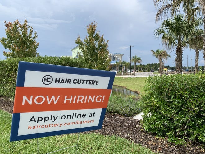 A hiring sign can be seen for the Hair Cuttery salon at the Latitude Landings shopping center on LPGA Boulevard, west of Interstate 95, on July 28, 2021.