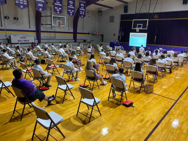 Ascension Catholic students attend orientation presented by Principal Sandy Pizzolato at the high school gym on Aug. 2.
