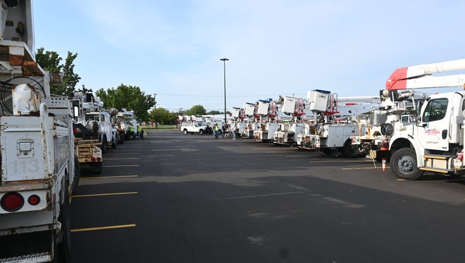 Two-dozens trucks with crews from Pack Power in Ohio rendezvous at Coldwater Wednesday night before beginning power restoration work for Consumers Energy.