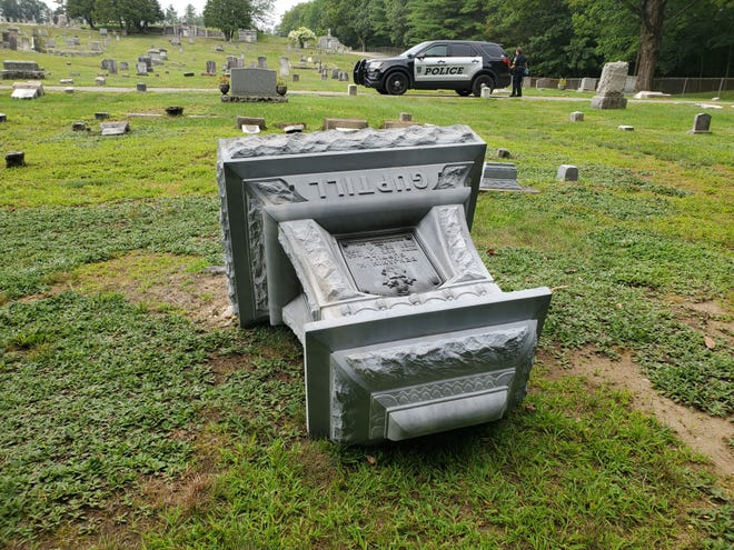 More than 100 graves were vandalized in the early hours of Wednesday, Aug. 11, 2021, at Pine Grove Cemetery in Farmington.