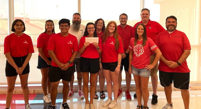 Prior to Meet the Tigers on Friday night, the Glen Rose Athletic Booster Club presented a $5,000 check to the Glen Rose Band Booster Club at Tiger Arena. From left, GR band members Avril Tovar, MacKenzie Campos, DeShawn Magana, Michael Thrasher (GR Band Booster Club President), Caroline Davis, Emily Andrews (GR Band Booster), Elizabeth Locke, Colin Schafer (GR Band Booster), Jessica Douglas (GRABC President-Elect), Jay Hinton (GRABC President) and Ray Portillo (GR Tiger Pride Band Director).