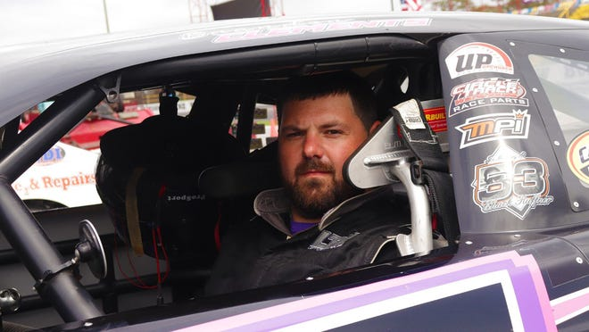 Brandon Clements sits inside his Late Model prior to a CARS Tour race.