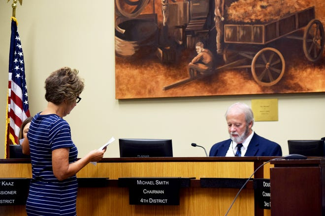 County Clerk Janet Klasinski presents information about the Aug. 3 primary election to Leavenworth County commissioners. Also pictured is County Commission Chairman Mike Smith. Commissioners voted Wednesday to certify the results of the primary.