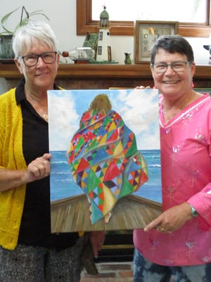 Local artist Lee Stedcke and Under His Wings Quilt Ministry founder, Cheryl Smith, pose with the painting that Stedcke has donated for a silent auction benefitting the ministry. The auction will run through the month of September as part of the ministry's annual quilt show at the Bedford Branch Library.
