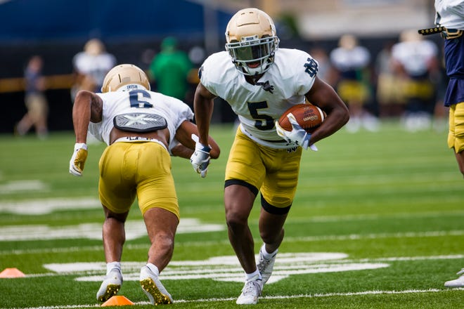 Irish cornerbacks Cam Hart (5) and Clarence Lewis (6) run a drill during Notre Dame football practice Thursday, Aug. 12, 2021 at ND.