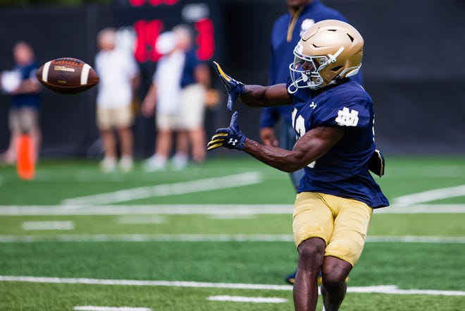 Departing wide receiver Lawrence Keys III tracks a pass during Notre Dame football practice Thursday, Aug. 12, 2021, at the LaBar Practice Complex. He is no longer in the Irish roster.