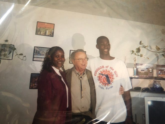 North Marion head football coach and former FSU wide receiver Greg Carr, right, pictured as a high schooler with Bobby Bowden, center, and Carr's mother, left, remembers coach Bowden for his focus on faith, family and football.