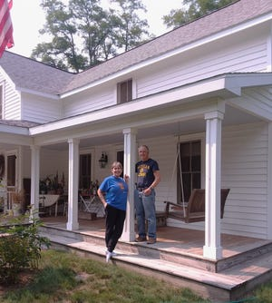Norwood Village historic homeowners Chet and Dawn Hardwith restored Jackson Hotel/Liveryand stagecoach stop.