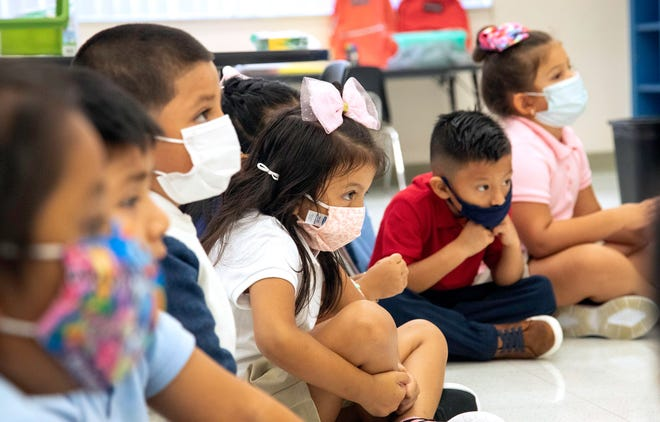 Masked up students in Aida Cuevas Villegas' Spanish dual language kindergarten class at Belvedere Elementary School in West Palm Beach Tuesday, Aug. 10, 2021, the first day of the school year.