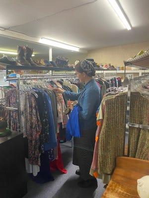 Rosina Schmuker shops for clothing at Brenda's Treasures in Pratt.