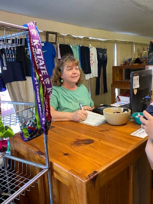 Brenda Venard chats with a customer at her store on South Main Street in Pratt.