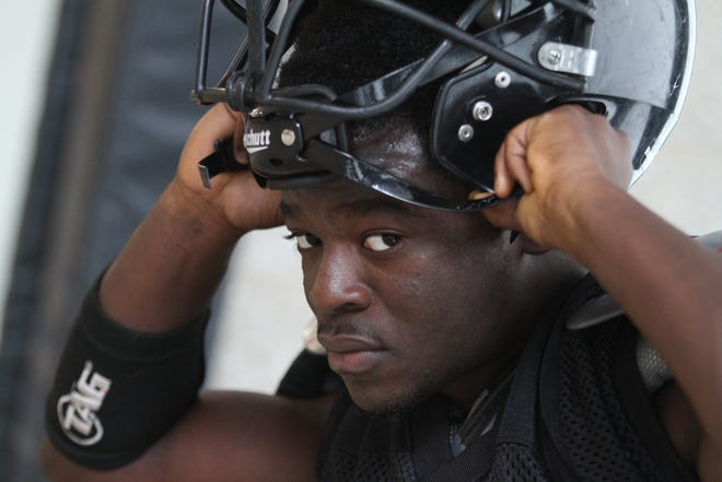 Michael Washington, now the football coach at Central High School, is shown during an indoor practice in September 2011, when he was a star running back at the school.