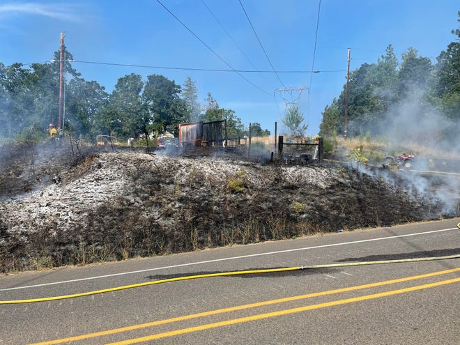 Fire crews extinguished a brush fire on Bailey Hill Road on Thursday morning in Eugene.
