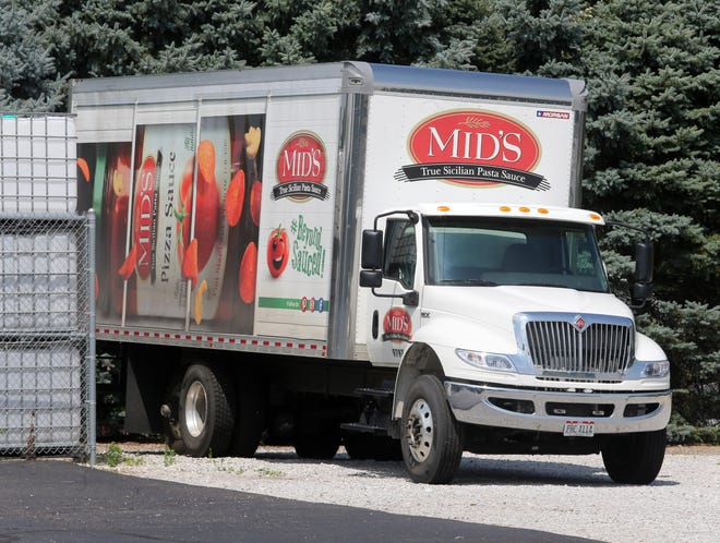 Mid's has been buying up land and houses in recent years, spending $507,500 to get eightparcels near its sauce plant in Navarre.