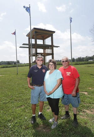 Randy Branch, left, retired fire chief of Osnaburg Township, along with his wife, Jackie, a member of the Stark County Firefighters Association, with Jerry Markle, vice president of the Stark County Firefighters Association and chairperson of the Firefighters Memorial Committee, stand at the site of the ongoing project in Washington Township.