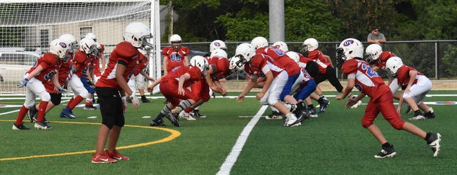 Ready for the next play, the Patriots show off their moves at the line of scrimmage.