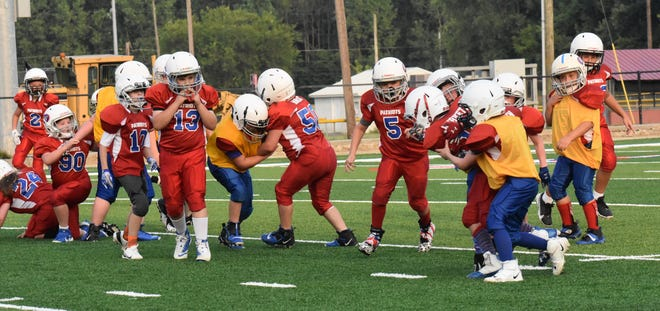 Ready for their time on the field, youth football players from first grade through sixth grade joined their middle school and high school counterparts as part of the Patriot Night intersquad scrimmages.