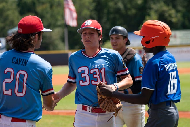 Beverly Post 331 pitcher Noah Guanci, middle, is greeting by teammates after an inning of the opening day game between Dubuque County, Iowa, and Beverly Post 331 at Keeter Stadium in Shelby, North Carolina, on Aug. 12, 2021.
