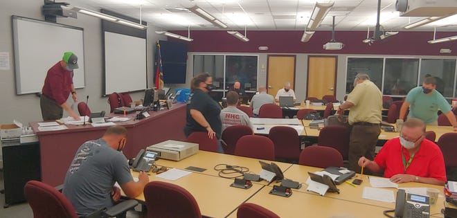 North Carolina regional emergency management personnel prepare to test communication and mobilization skills at the New Hanover Emergency Operations Center.