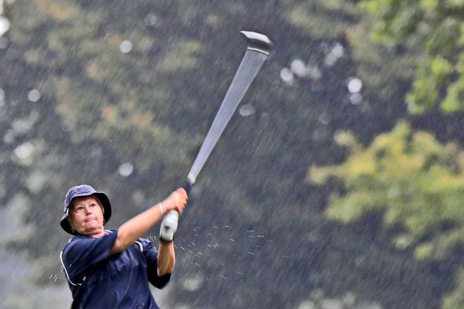 Linda Lemieux drives the ball under pouring rain conditions in the final round of the Country Club of New Bedford Women's Four-Ball.