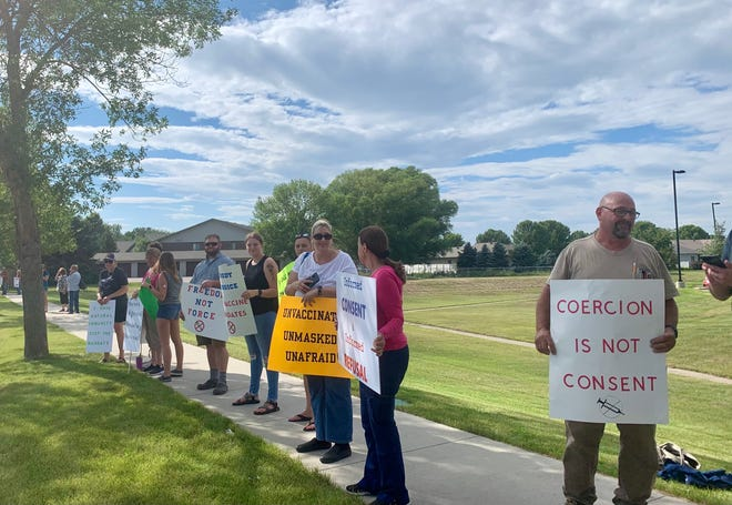 Protesters who are against a vaccine mandate gathered outside of Sanford Aberdeen Medical Center Wednesday evening.