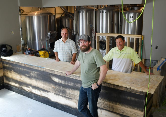The Double Down Brewing Co. team includes, from left, co-founder Christian McMahan, brewer Brian Wells and co-founder Tom Oliveri. The new brewery, located in space at Peppercorn's last occupied by Flying Dreams, is set to open in September.