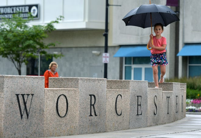 A little girl walks atop the Worcester Common blocks at Front and Church streets in a 2019 file photo.
