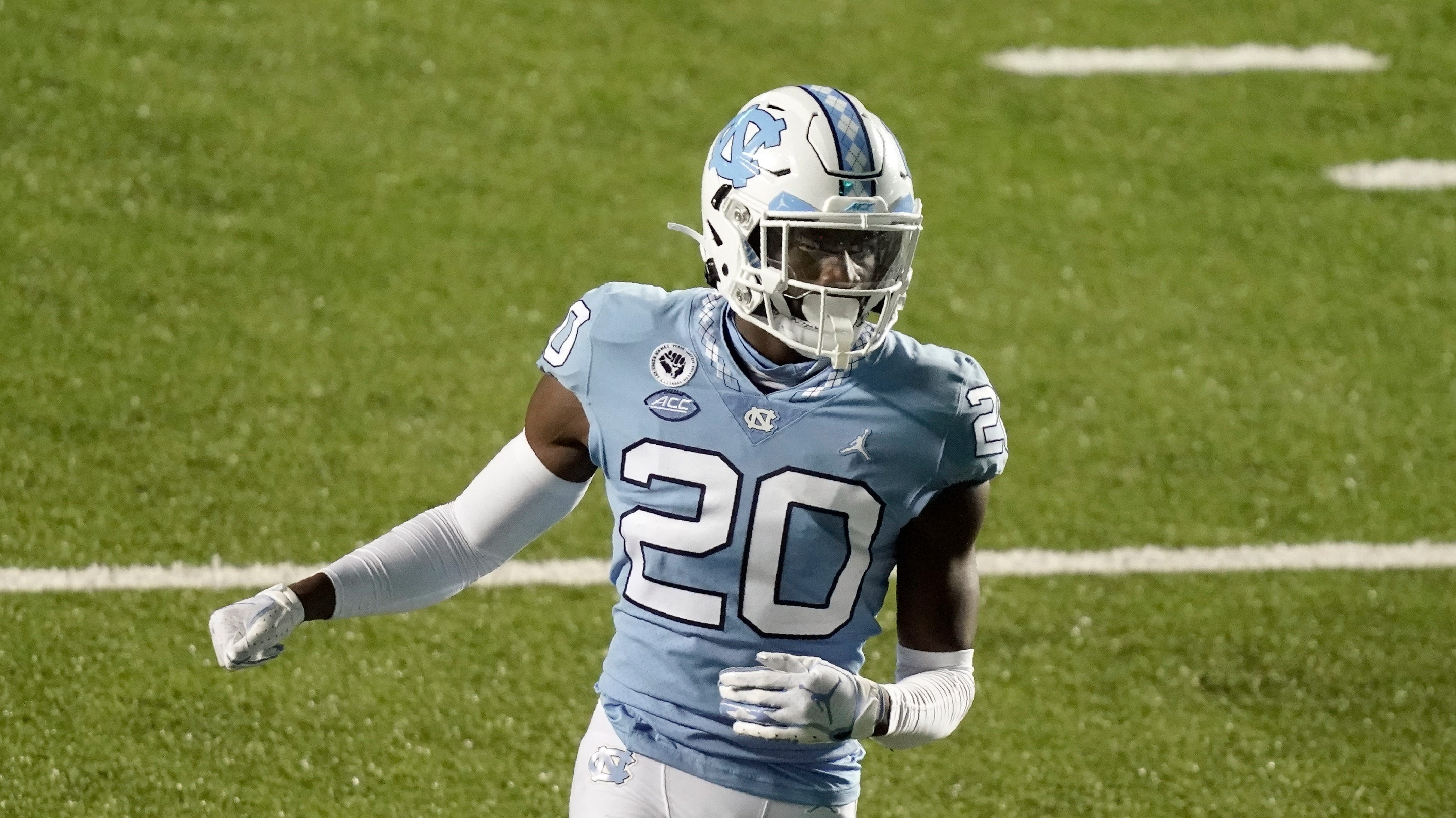 North Carolina defensive back Tony Grimes (20) runs a play against Notre Dame during the second half of an NCAA college football game in Chapel Hill, N.C., Friday, Nov. 27, 2020. (AP Photo/Gerry Broome)
