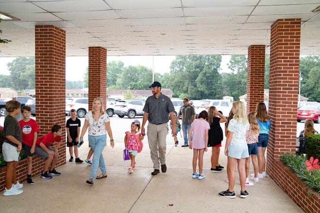 Students and parents  arrive at Southside Elementary School on Thursday for the first day of the 2021-22 school year.