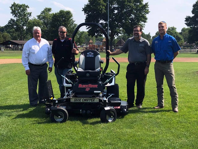 Gradall IndustriesInc. has donated a large lawn mower to the city of New Philadelphia to help meet maintenance needs at the city's new southside park.