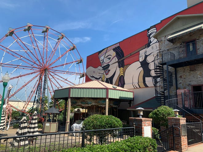 The 55-foot tall Ferris wheel and mural from artist D*Face are staples of the park and make it easily recognizable.