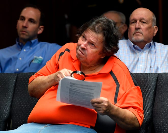 David Swart glances up while looking over the agenda during Thursday's Abilene City Council meeting. Swart is a frequent commenter, and often the only one doing so, on council issues during the public discussion portions of the meetings.