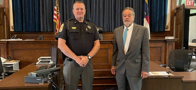 Marshall resident Richard Eugene Towe is charged with murder after authorities say he shot Cody Jonathan Garrett on Sept. 22, according to Sheriff Buddy Harwood, left, pictured with Clerk of Court Mark Cody.