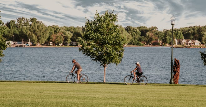Bicyclists ride around Storm Lake, which, at 3,200 acres, is the state's fourth largest natural lake and offers boating, swimming and more.