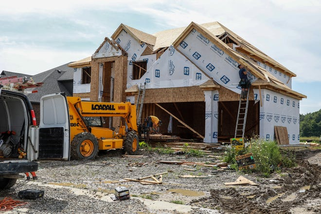 Leone Construction is building new homes in the Strathmore subdivision in Macomb Twp on Aug. 12, 2021.
